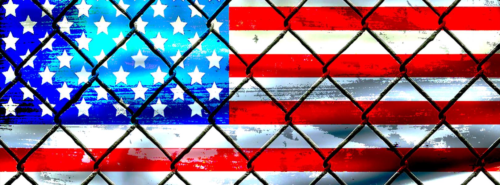 U.S. flag behind caged bars