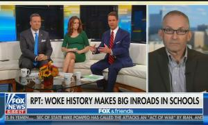 "Ed Henry, Jedediah Bila, and Griff Jenkins seated on the white couch on screen left, with guest John Murawski on screen right. Chyron reads: ""Report: Woke history makes big inroads in schools"""