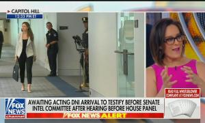 """Fox Business host Lisa Kennedy Montgomery speaking on screen right, with most of screen left being a live shot of a hallway in the US Capitol. Chyron reads """"Awaiting acting DNI arrival to testify before Senate Intel Committee after hearing before House panel"""""""