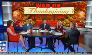 "Hosts of Fox News' The Five sitting in front of a graphic reading ""War on Thanksgiving"""