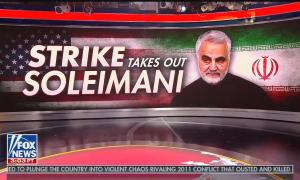 "A wall-sized Fox News graphic reading ""Strike takes out Soleimani"" with a photo of the deceased general"