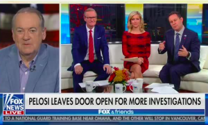 """Mike Huckabee screen left via satellite in front of a US flag background, with the Fox & Friends hosts seated in studio on screen right. Chyron reads """"Pelosi Leaves Door Open For More Investigations"""""""