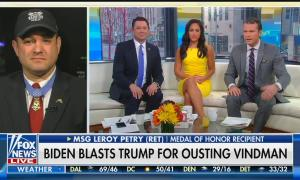 "Medal of Honor recipient Leroy Petry (wearing his medal) on screen left with Fox & Friends weekend co-hosts Jason Chaffetz, Emily Compagno, and Pete Hegseth on screen right. Chyron reads ""Biden Blasts Trump For Ousting Vindman"""