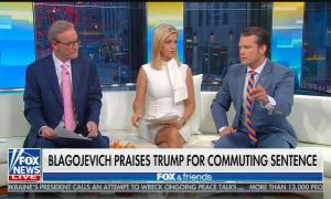 "Fox & Friends hosts STeve DOocy, Ainsley Earhardt, and Pete Hegseth sitting above a chyron reading ""Blagojevich Praises Trump For Commuting Sentence"""