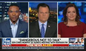 "Fox News contributor Richard Fowler on screen left, Fox reporter and guest anchor Mike Emanuel in the center, and Fox contributor Mollie Hemingway on screen right. Chyron reads ""'Dangerous Not To Talk': Sen Chris Murphy (D) Admits Meeting With Iranian FM"""