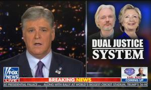 "Sean Hannity hosts his show with graphic of Julian Assange and Hillary Clinton saying ""Dual justice system"""
