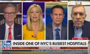 """The Fox & Friends host and a guest above a chyron reading """"Inside one of NYC's busiest hospitals"""""""