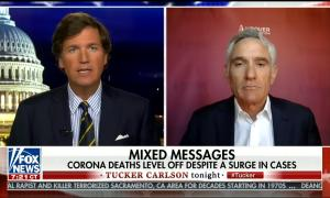 Tucker Carlson downplays surge in coronavirus cases