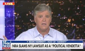 """Fox host Sean Hannity speaking above a chyron reading """"NRA slams NY lawsuit as a 'political vendetta'"""""""