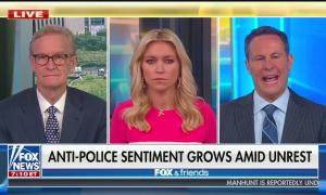 """The hosts of Fox & Friends with chyron """"Anti-Police Sentiment Grows Amid Unrest"""""""