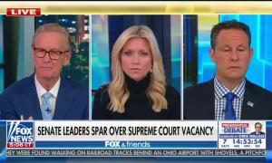 """The three Fox & Friends co-hosts, socially distanced in-studio, with chyron """"Senate leaders spar over Supreme Court vacancy"""""""