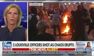 """chyron reads, """"2 LOUISVILLE OFFICERS SHOT AS CHAOS ERUPTS"""""""