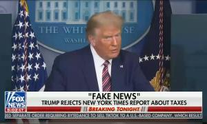 "President Trump at podium at press conference, chyron reads ""Fake News"""
