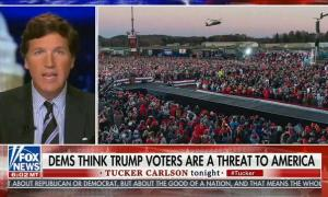 "Tucker Carlson warns Democrats will wage ""an actual war, a war on our own people"" to ""root out"" Trump supporters"
