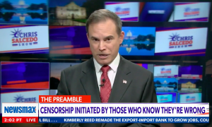 "Newsmax host Chris Salcedo in studio above a chyron reading ""Censorship initiated by those who know they're wrong"""