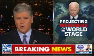 "A screenshot of Fox News' ""Hannity"", with Sean Hannity speaking at left and a graphic of a sad-looking Joe Biden superimposed on a world map, with text reading ""Projecting Weakness On The World Stage,"" with ""weakness"" in red and other text in white. Chyron reads ""BREAKING NEWS"" in white and yellow text against a red background."