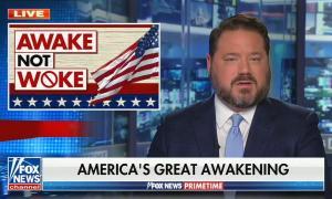 "Ben Domenech addresses camera; photo is corner says ""AMERICA NOT WOKE""; chyron reads: America's great awakening"