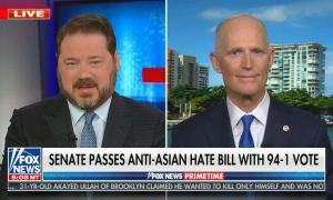 still of Pete Hegseth; chyron: Dems push their socialist agenda on America; graphic of Capitol building titled, 'America vs The Swamp'