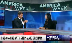 Eric Bolling sitting at America This Week desk with Stephanie Grisham