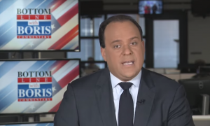 "Still of Boris Epshteyn narrating his segment in front of a ""Bottom Line with Boris'"" logo"