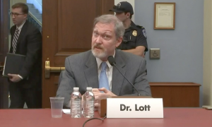 John Lott gets called out by a senator during a hearing