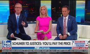"Steve Doocy, Ainsley Earhardt, and Brian Kilmeade above a chyron reading ""Schumer to Justices: You'll Pay The Price"""