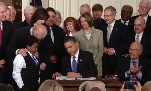 obamacare-signed.jpg