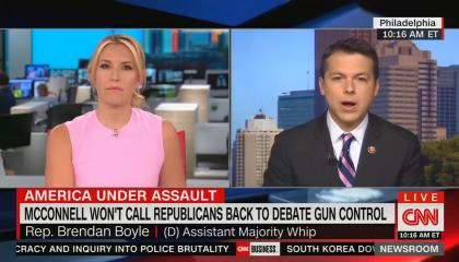 "CNN anchor Poppy Harlow screen left, and House Assistant Majority Whip Rep. Brendan Boyle (D-PA) screen right. Chyron reads ""America under assault: McConnell won't call Republicans back to debate gun control"""