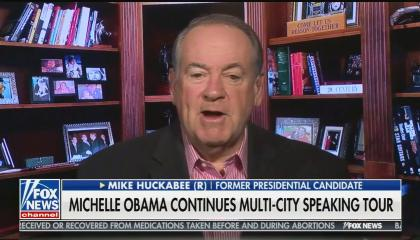 "Mike Huckabee speaking in a small library, with a chyron reading ""Michelle Obama continues multi-city speaking tour"""