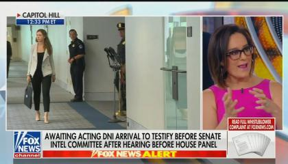 "Fox Business host Lisa Kennedy Montgomery speaking on screen right, with most of screen left being a live shot of a hallway in the US Capitol. Chyron reads ""Awaiting acting DNI arrival to testify before Senate Intel Committee after hearing before House panel"""