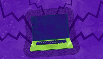 Green laptop on a purple background