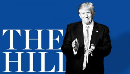 Trump standing in front of The Hill's logo