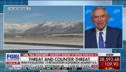 "An F-35A fighter taking off from a Utah air base on screen left, with former Amb. Paul Wolfowitz on screen right. Chyron reads ""Threat and Counter-Threat: Iran evaluating 13 retaliation scenarios against U.S."""
