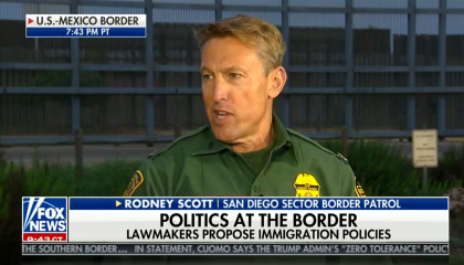 "Former San Diego Sector Border Patrol agent Rodney Scott, in uniform in front of border fencing on The Ingraham Angle in June 2018. Chyron reads ""Politics at the border: Lawmakers propose immigration policies"""