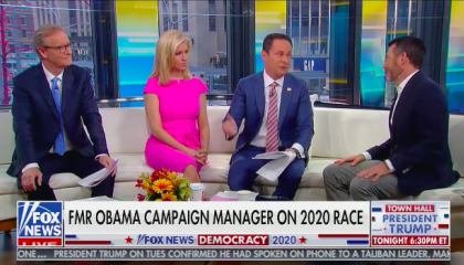 "Co-hosts Steve Doocy, Ainsley Earhardt, and Brian Kilmeade seated on a white couch next to David Plouffe, on the right. Chyron reads ""Fmr Obama Campaign Manager On 2020 Race"""