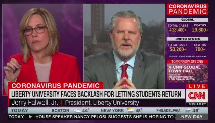 Liberty University president Jerry Falwell Jr speaking to CNN anchor Alisyn Camerota. Data about the coronavirus pandemic occupies the right third of the screen