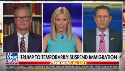 """The hosts of Fox & Friends with a chyron reading """"Trump to temporarily suspend immigration"""""""