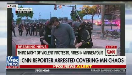 """A screenshot of CNN reporter Omar Jimenez's arrest live on CNN this morning, as replayed by Fox news. Fox's chyron reads """"CNN reporter arrested covering MN chaos"""""""