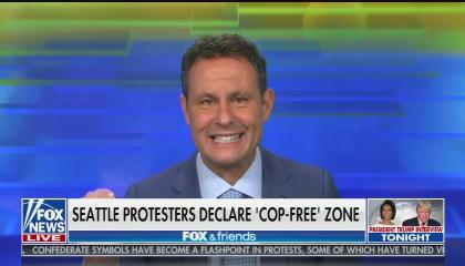 "Fox host Brian Kilmeade gesticulating while speaking; chyron reads ""Seattle protesters declare 'cop-free' zone"""