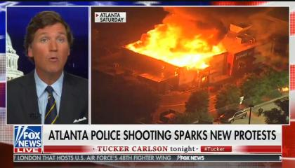 """chyron reads: """"Atlanta police shooting sparks new protests"""""""