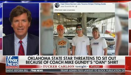 Tucker Carlson defends Oklahoma State coach Mike Gundy amid uproar over his support of conspiracy theory peddling network OAN