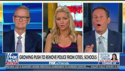 """The three co-hosts of Fox & Friends discussing what the chyron calls a """"growing push to remove police from cities, schools"""""""