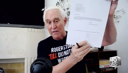 Roger Stone signs paperwork hd