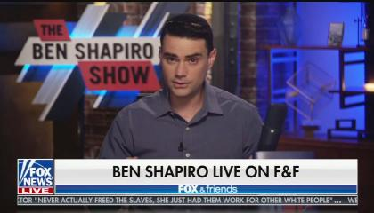 """Ben SHapiro sitting in front of the background for his podcast """"The Ben Shapiro Show"""" above a chyron reading """"Ben Shapiro Life On F&F"""""""