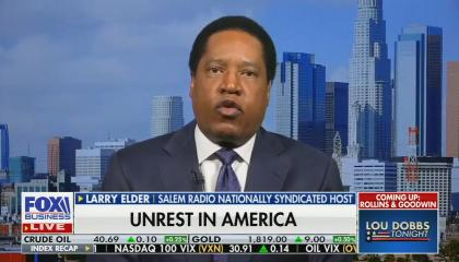 "chyron reads: ""Unrest in America"""