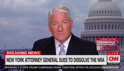 "CNN anchor John King above a chyron reading ""New York attorney general sues to dissolve NRA"""