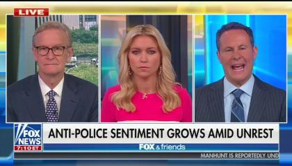 "The hosts of Fox & Friends with chyron ""Anti-Police Sentiment Grows Amid Unrest"""