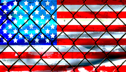 U.S. flag behind caged bars