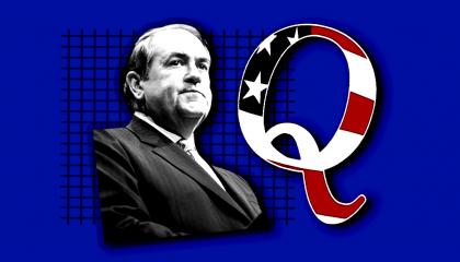An image of Mike Huckabee and a QAnon logo