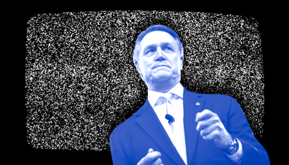 Sen. David Perdue (R-GA) in front of a TV showing static